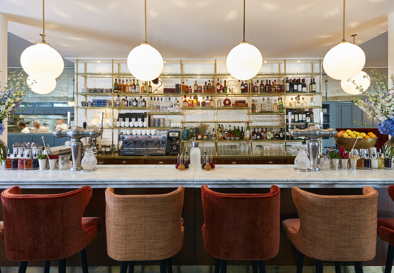 A bright bar with comfy bar stools